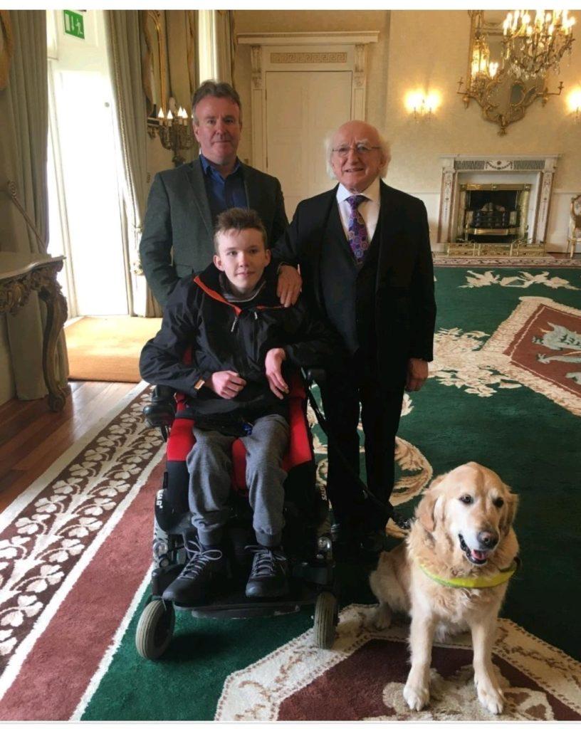 Tom Clonan, Eoghan, President Michael D Higgins and Duke the dog
